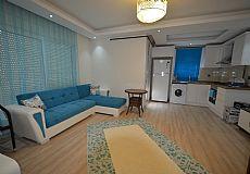 شقة مفروشة جديدة للبيع في منتجع جميل في كونيالتي انطاليا تركيا